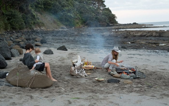 Wild Delicious Gallery image family beach lunch cooking over coals