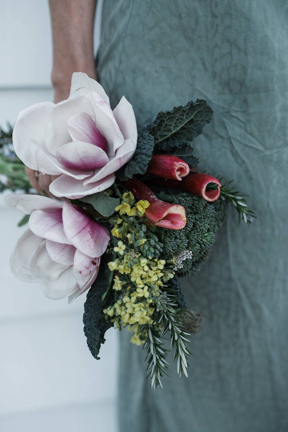 Wild delicious Gallery image floral bouquet held by side